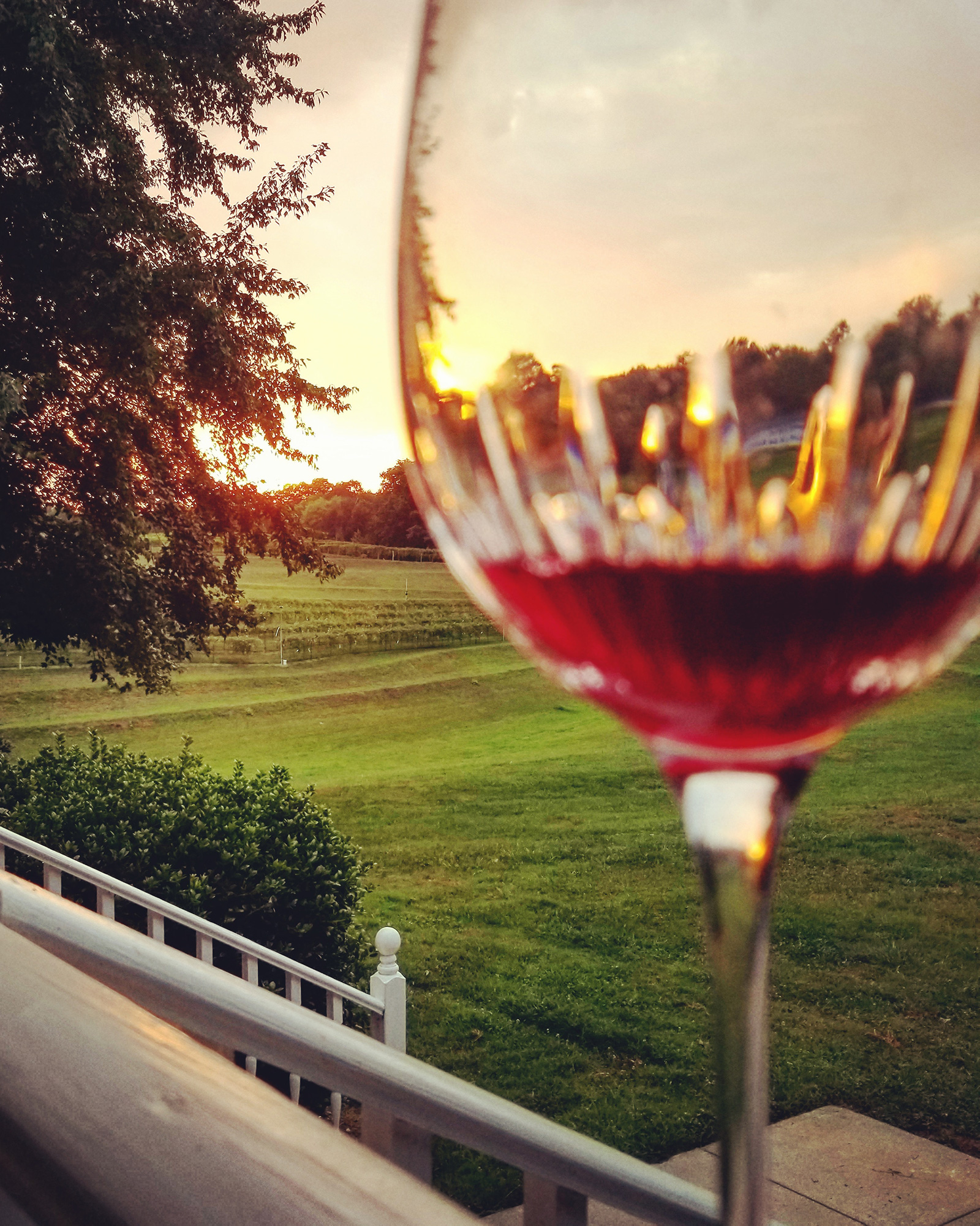 Glass of red wine on a porch