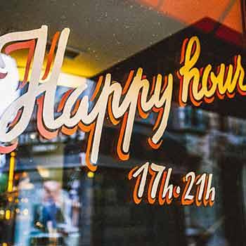 Window sign saying Happy Hour