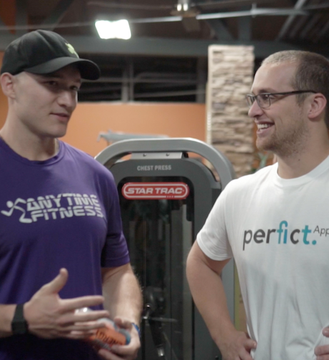 WeStrive founder Cory McKane and a personal trainer