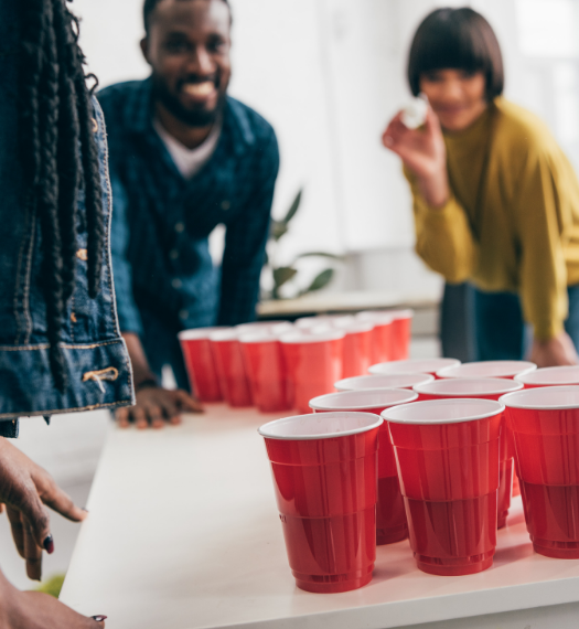 WeStrive users playing Beer Pong