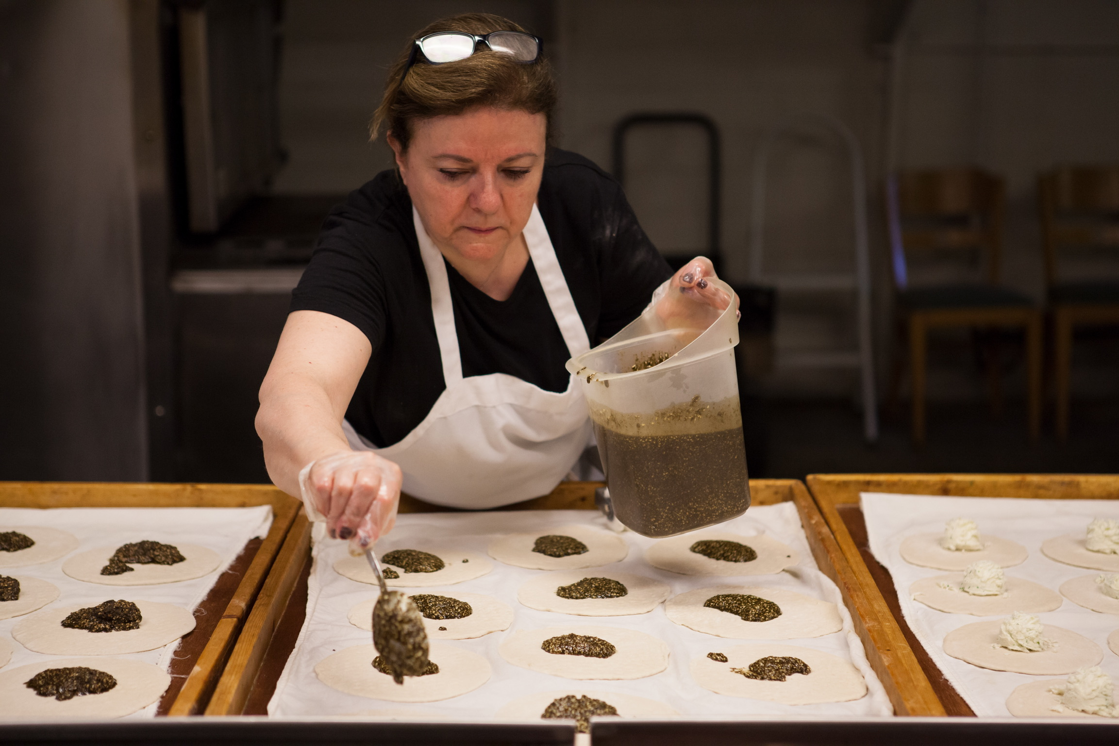 Norma Touma, owner of Sanabel Middle East Bakery, making fresh Zaatar pies.