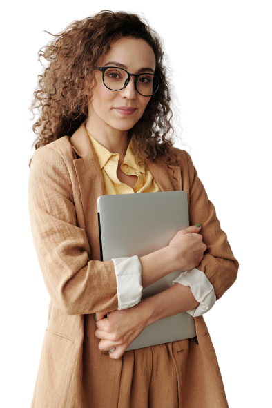 Woman standing with her laptop in her arms looking at the camera