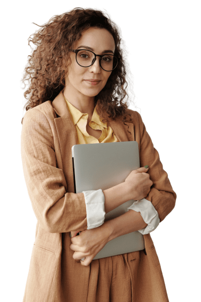 Woman standing with laptop in her arms