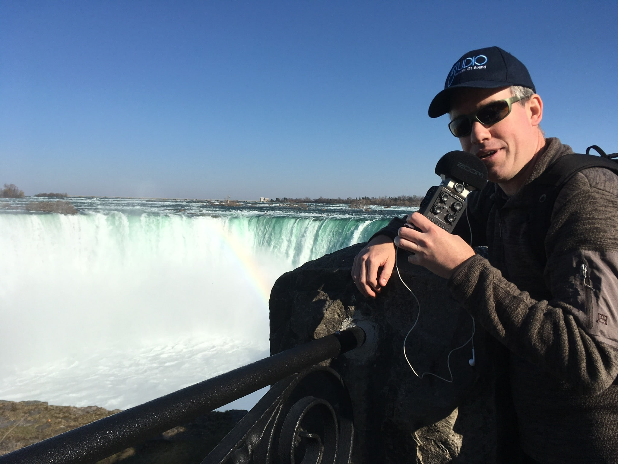 Podcast manager Ted Cragg recording a podcast next to Niagara Falls