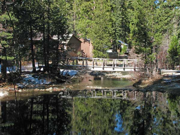 Graeagle Creek near several cabins of Gray Eagle Lodge has a foot bridge crossing the water.