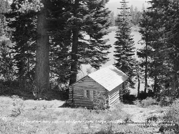 A small log cabin looking down at Packer Lake in 1946.