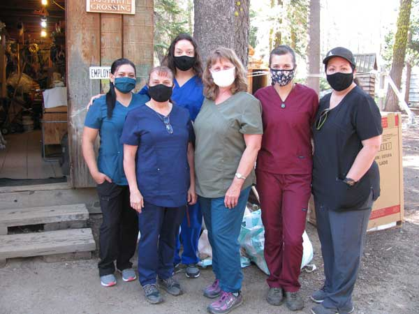 Our cleaning staff of six wearing masks that sanitize the cabins on Saturday