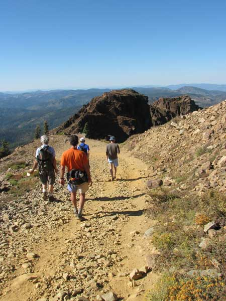 You hike along a gravel road to the Sierra Buttes.