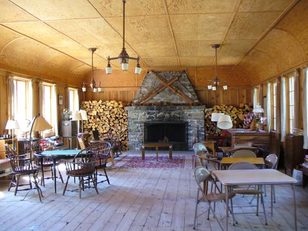 Recreation Hall at Elwell Lakes Lodge has a fireplace, tables, games and a piano.