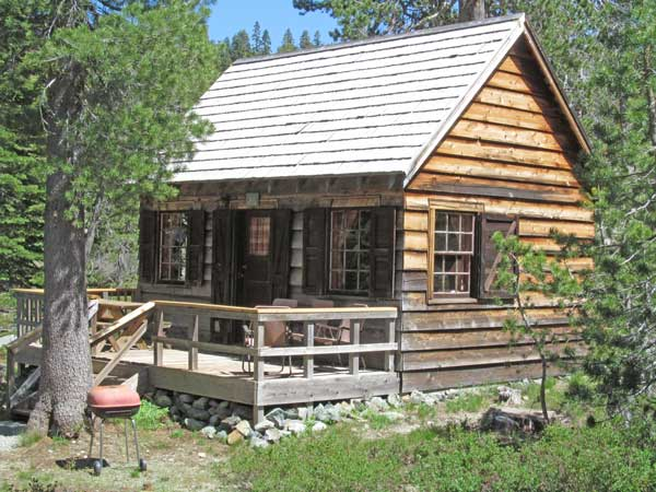 Marcus cabin view of outside has a picnic table and chairs on the deck