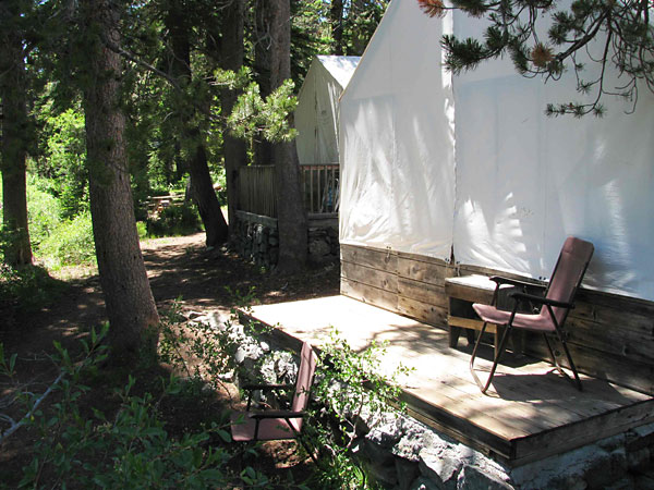 Tent cabins are warm inside because of the sunshine  hitting the canvas roofs.