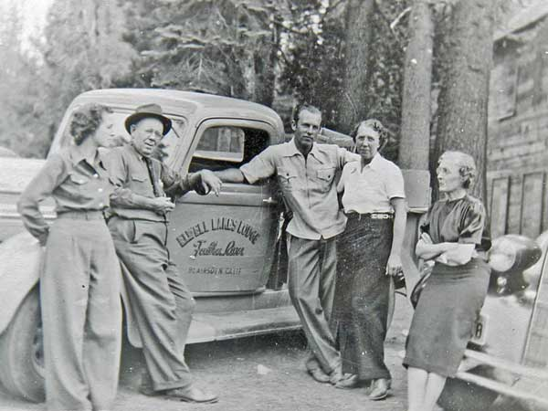The Drew family standing next to the lodge truck just before they depart for home about 1935