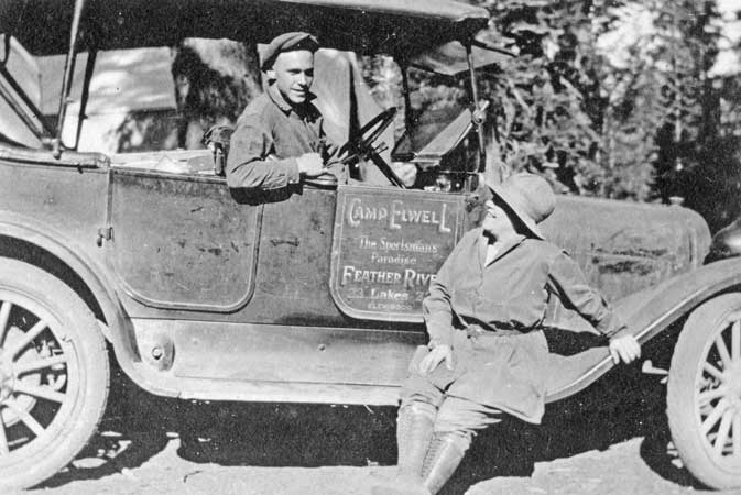 Camp Elwell Stage car with driver and woman guest
