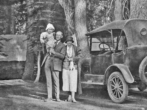 Mr. and Mrs. Marcus arriving at Camp Elwell about 1924 with baby beside the camp car