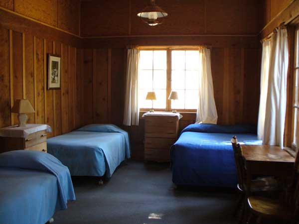 The front room in Andrews Cabin has one double and two single beds.