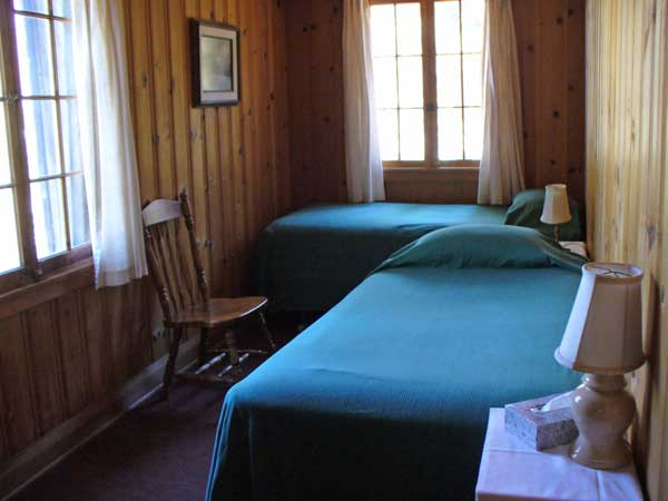 The back bedroom of Andrews cabin has two twin beds that can be made into a king bed.