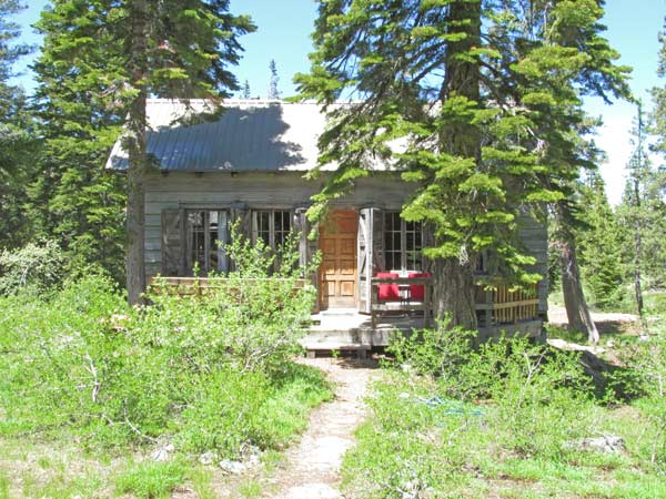 The front of Andrews Cabin with the path to the porch and front door.