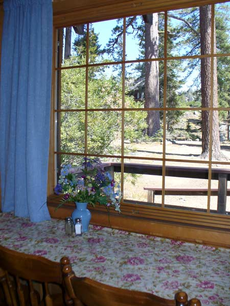 Childs Cabin window over the dining table looks out over the grounds and has a view of the Dining Hall on a hill.