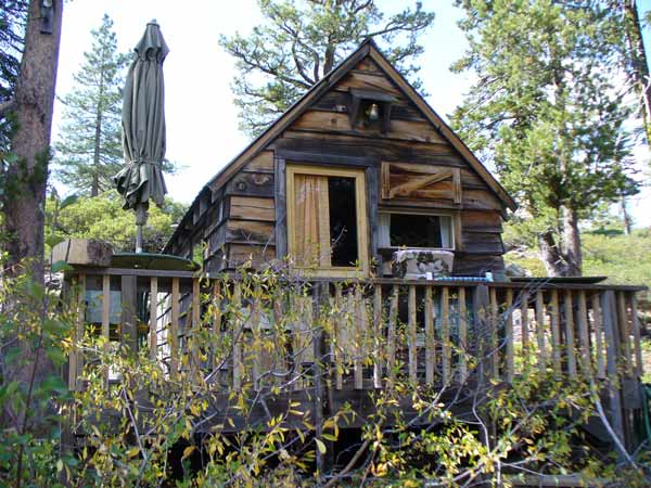 Frank Cabin is a cozy cabin with a porch that looks over the seasonal swimming hole.