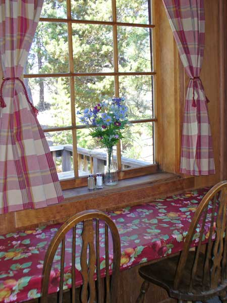 You can eat inside at a long narrow table looking out the many paned window.