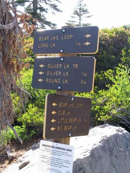 Trail signs direct you to many lakes in the Lakes Basin.