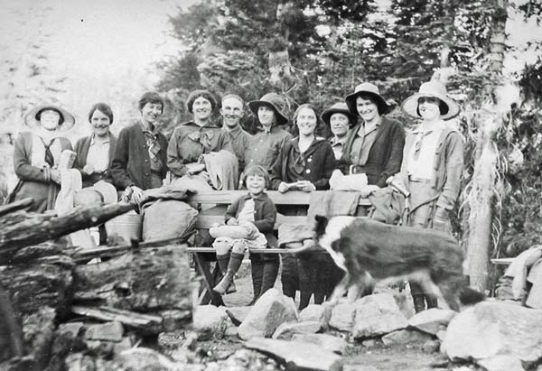 A group of ladies in the 1920's around the campfire circle with Miriam Drew