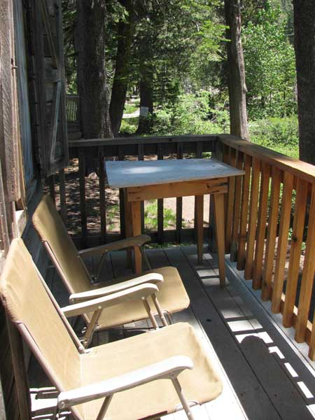 The porch of Cromwell Cabin is a pleasant spot to sit and watch the wildlife and hear the seasonal creek.
