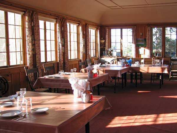 Dining Room set up for a Covid dinner. Sun comes through the windows in the afternoon.