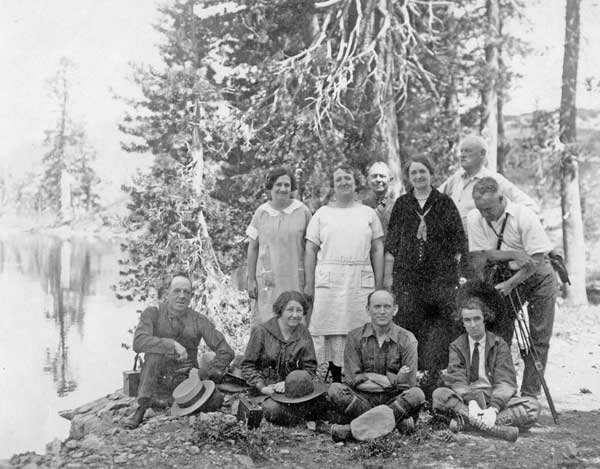 A group of men and women from Elwell in the 1920's at the shore of Big Bear Lake
