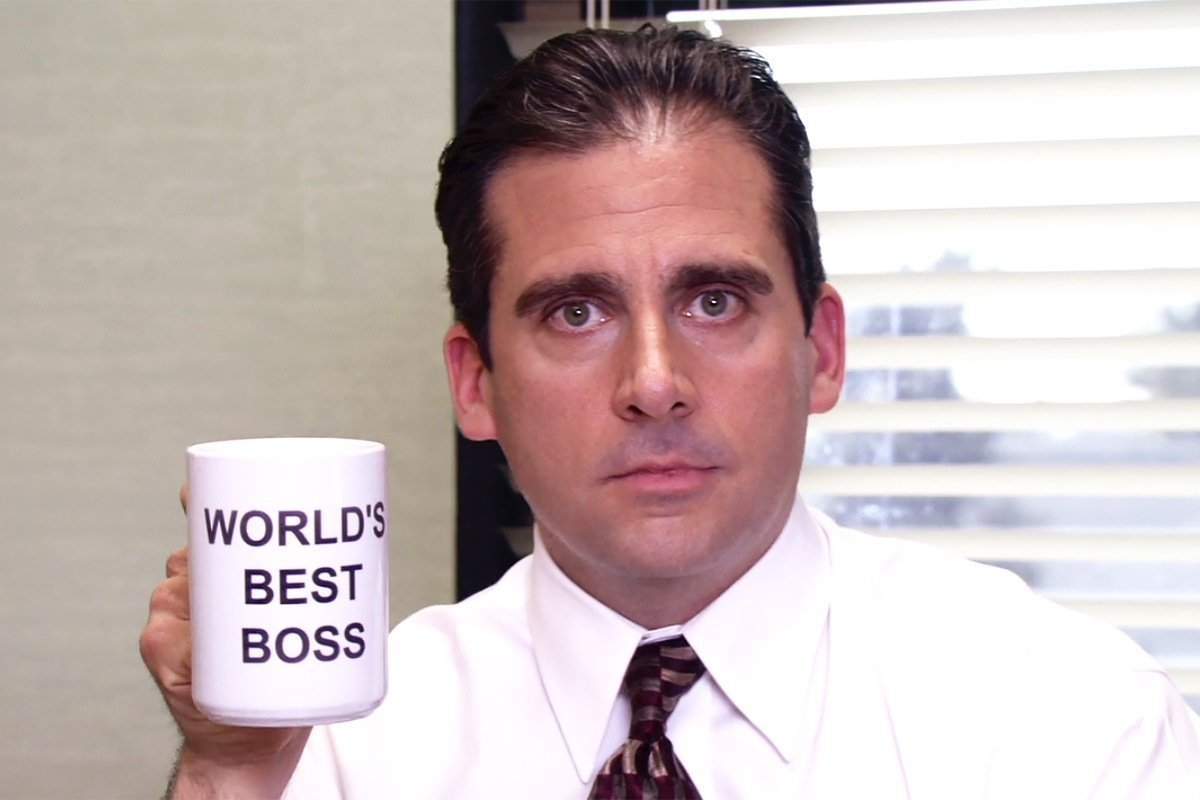 "Michael Scott from the television show The Office holding a mug that says ""World's Best Boss"""