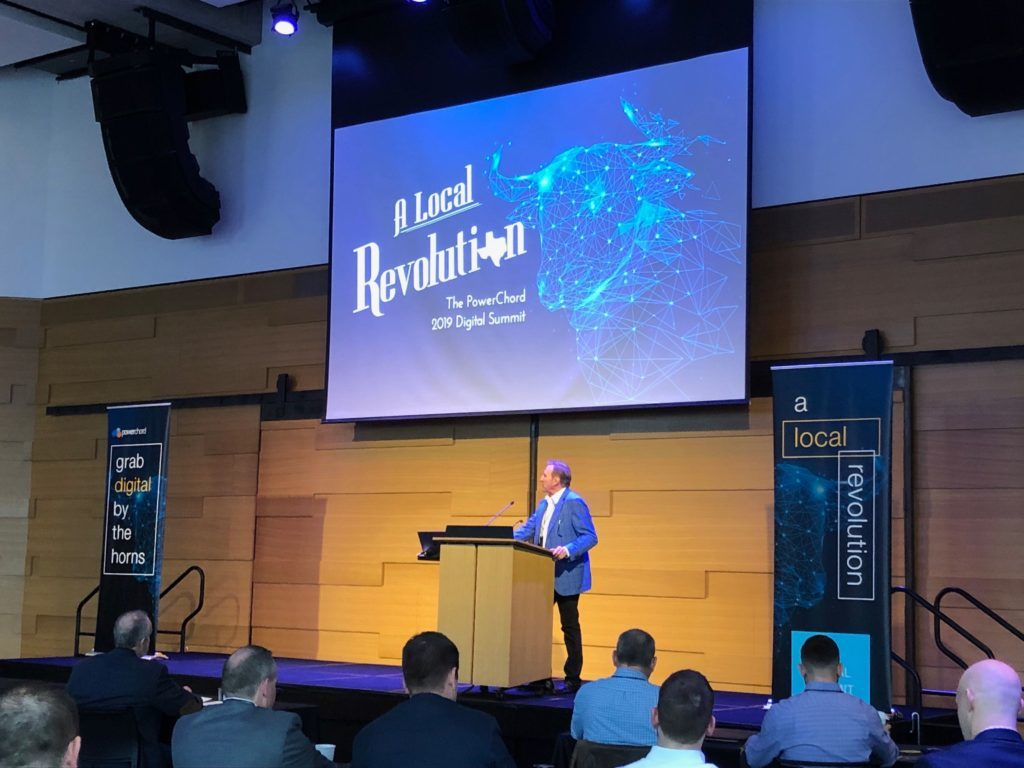 Lanny Tucker, PowerChord CEO, at podium during the 2019 PowerChord Digital Summit