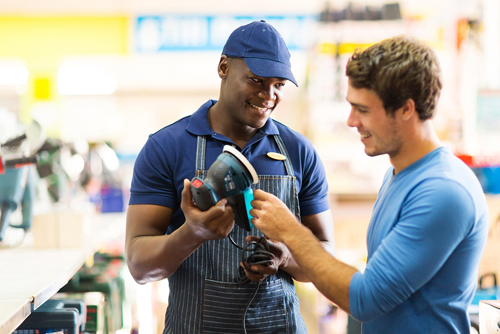 a store employee talking to a customer