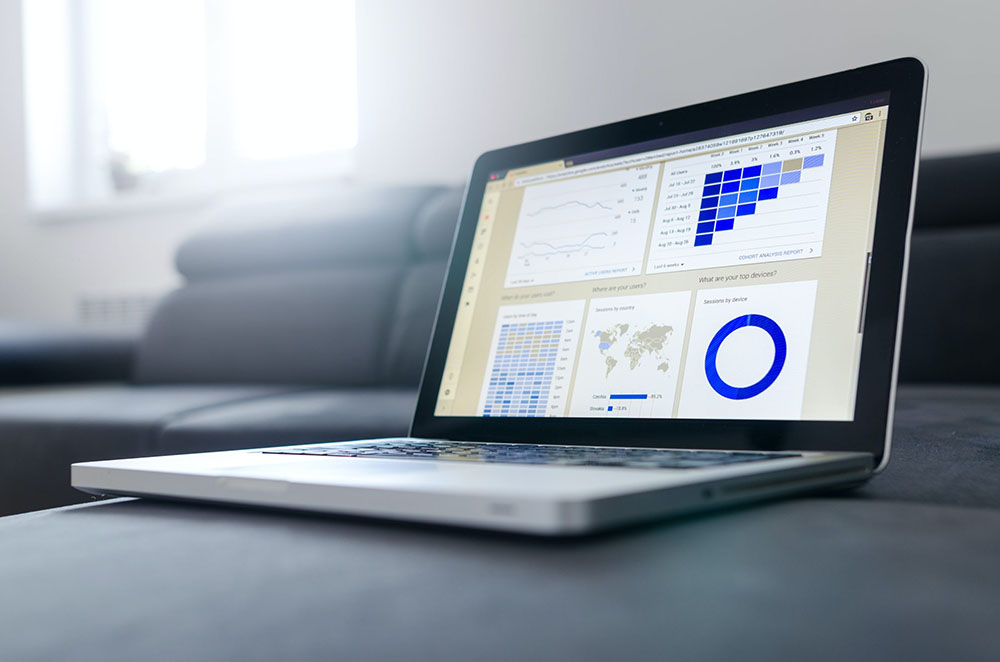 A laptop showing various charts and graphs