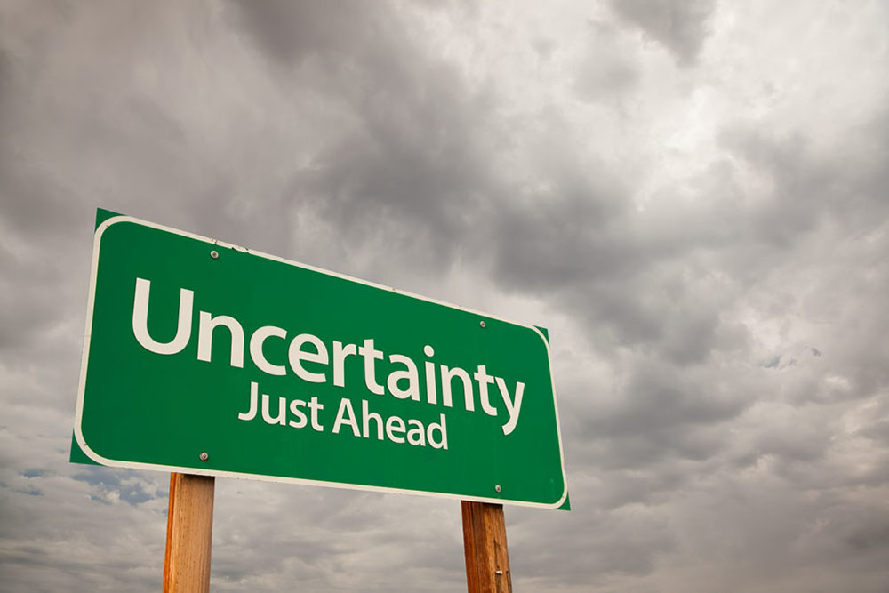 """A road sign with the words """"uncertainty just ahead"""""""
