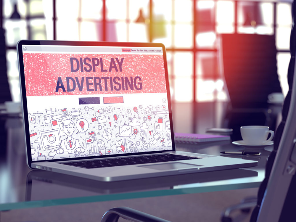"""A laptop showing the words """"display advertising"""""""