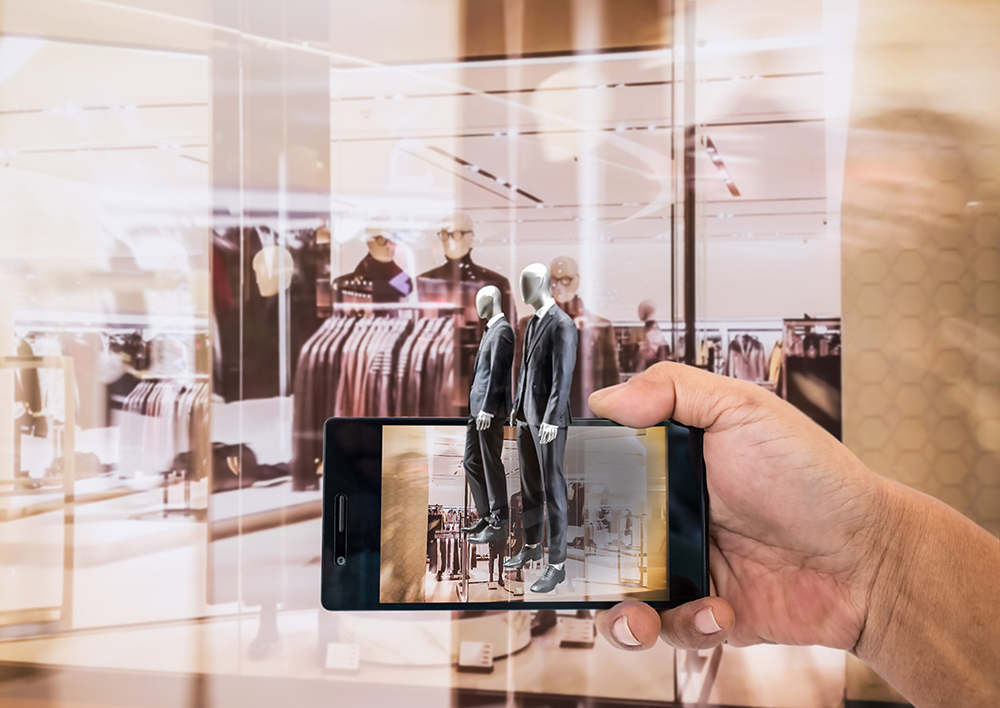 Experiencing branded augmented reality through a cell phone at a clothing store