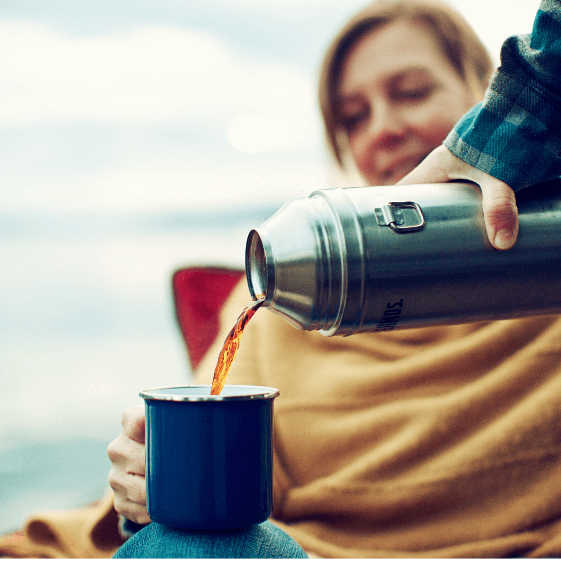 Husband pours coffee for wife
