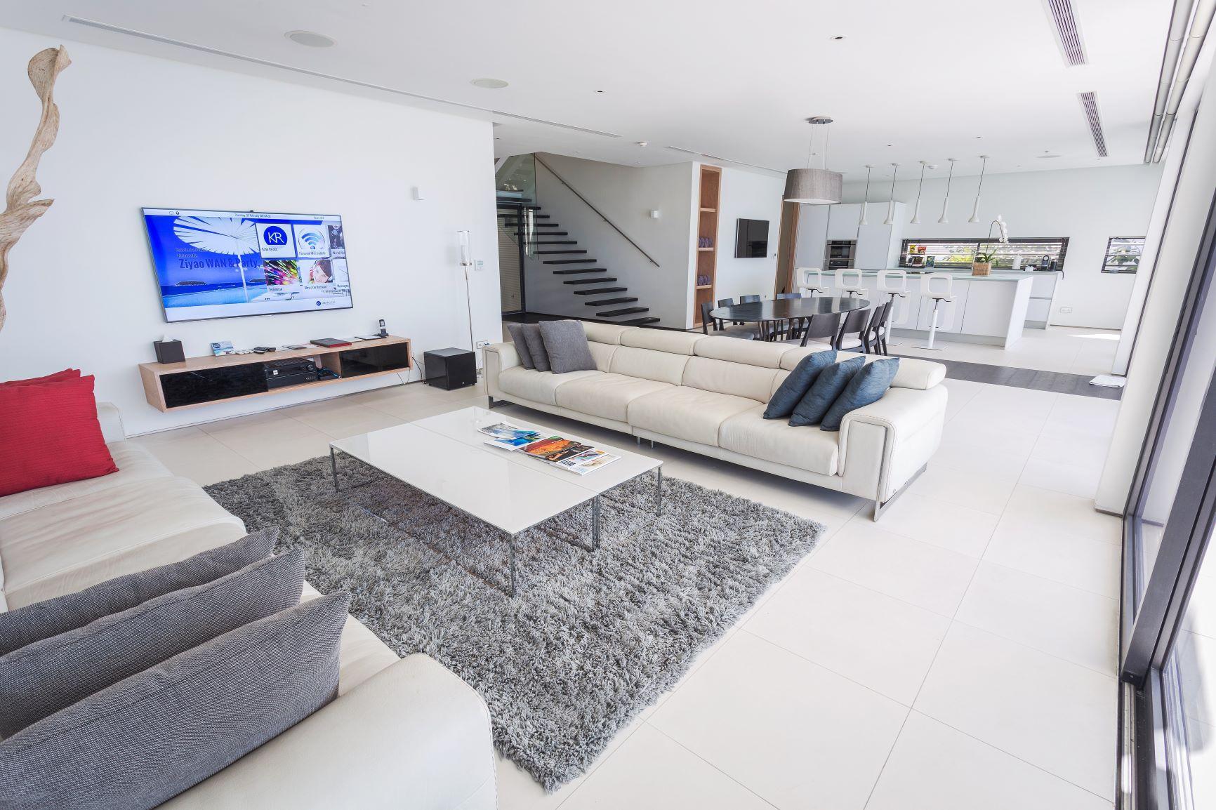 Open-floor plan showing entertainment area next to kitchen
