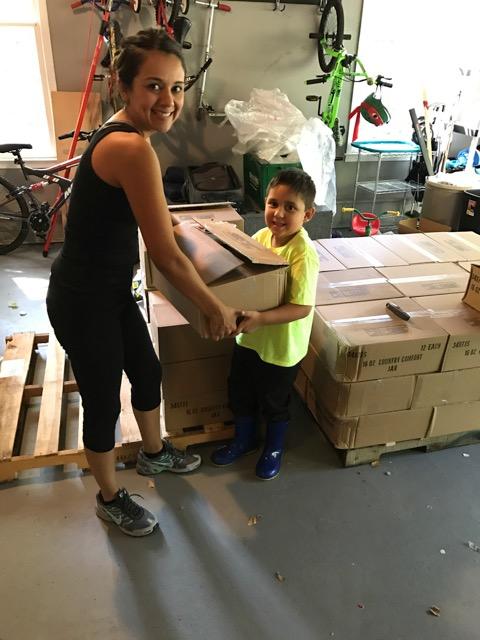 woman entrepreneur Margarita Eberline helped by son