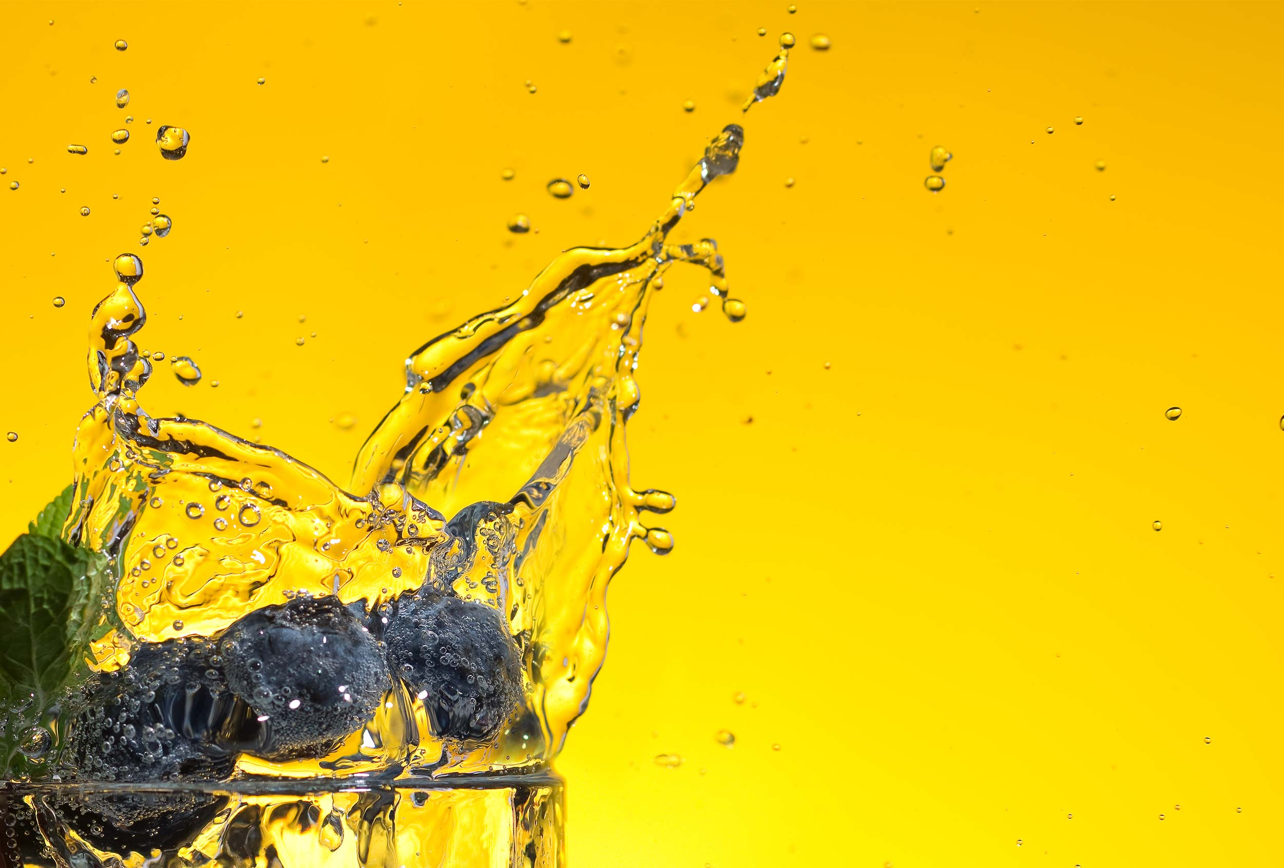 Close up tonic splash photography by Distil Studio, designed to promote Belu's work with WaterAid.