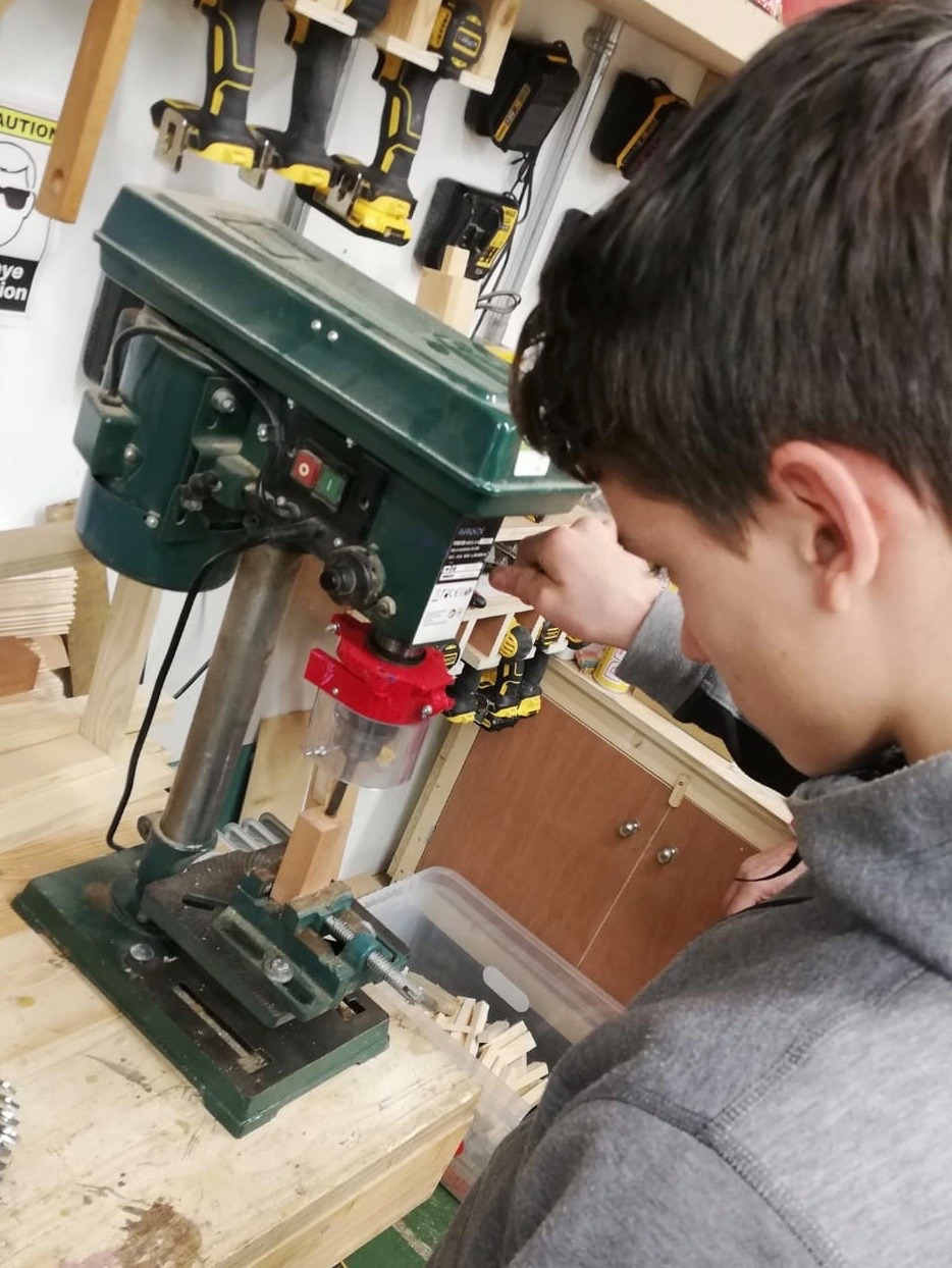 Young male operating woodwork machinery with Thrive at The Mix Stowmarket