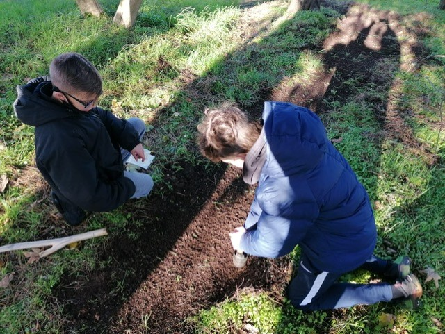two young males planting seeds with Thrive at The Mix Stowmarket