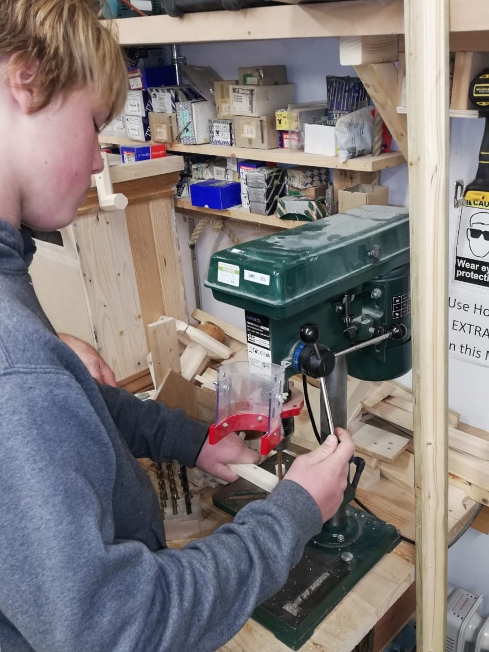 Young male using woodwork machine for Thrive at The Mix Stowmarket