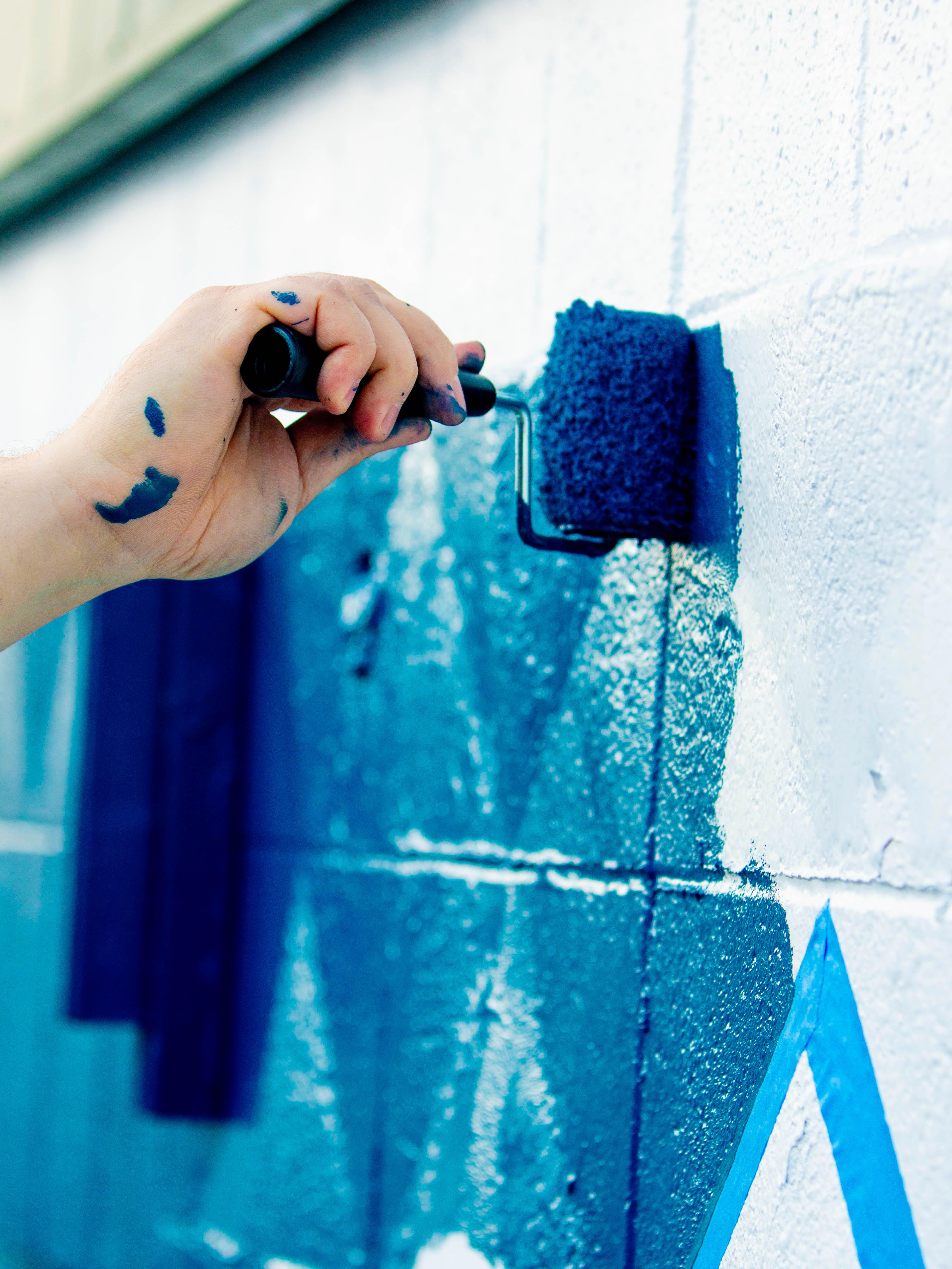 Paint roller on mural