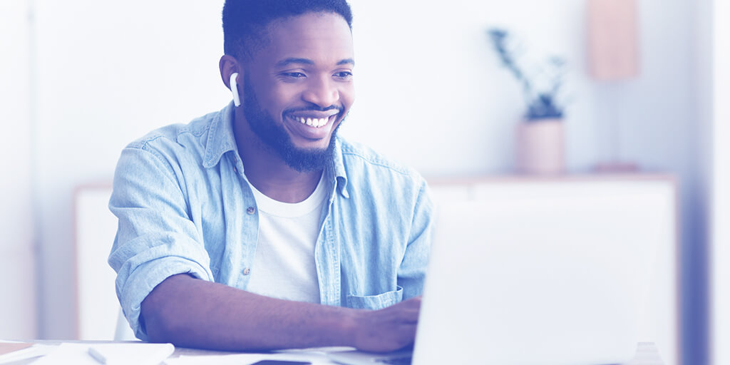 Smiling man at a laptop
