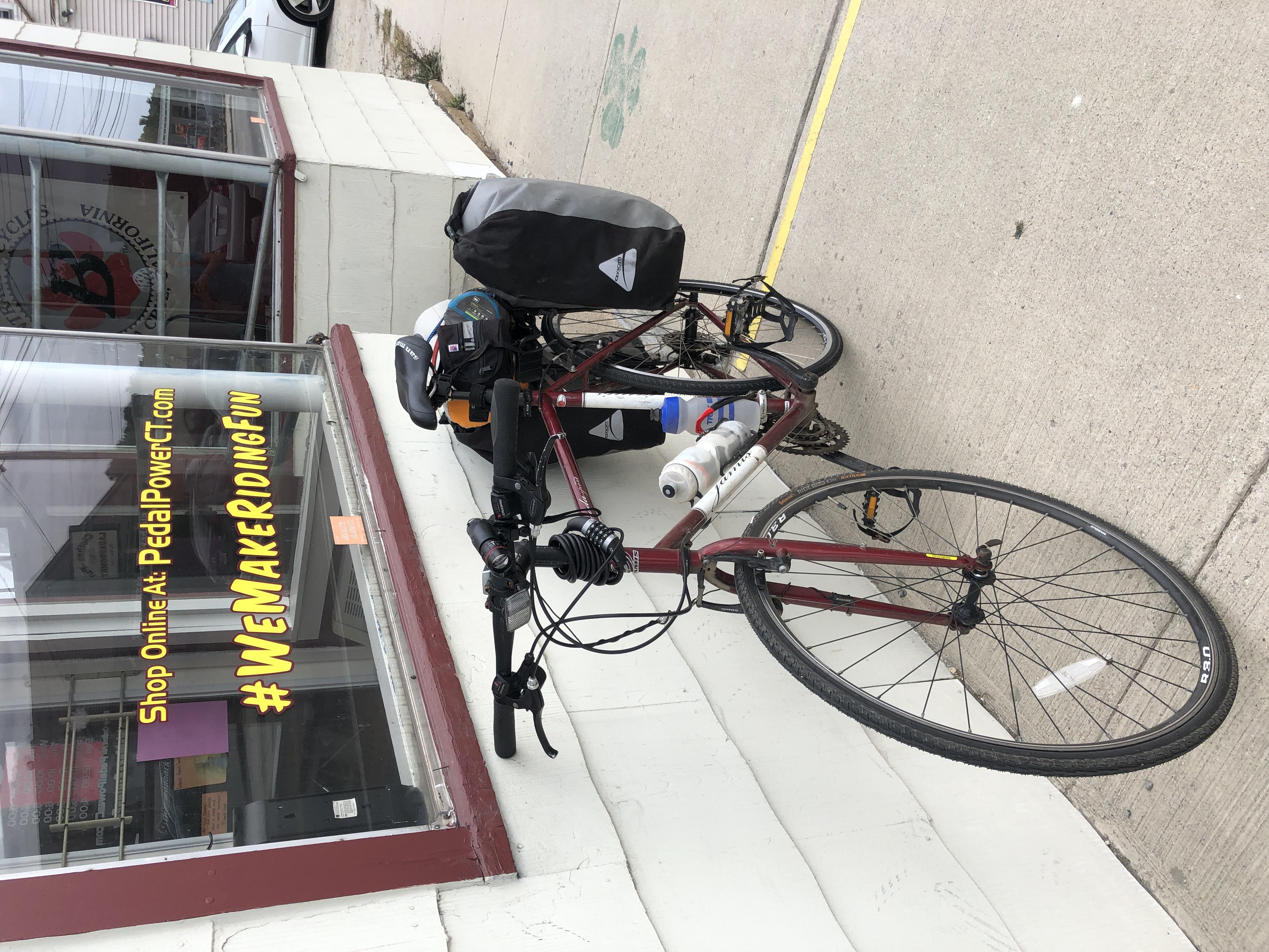 bike against the window of a bike shop