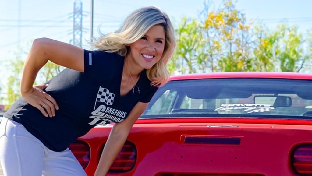 Tanya posed by car