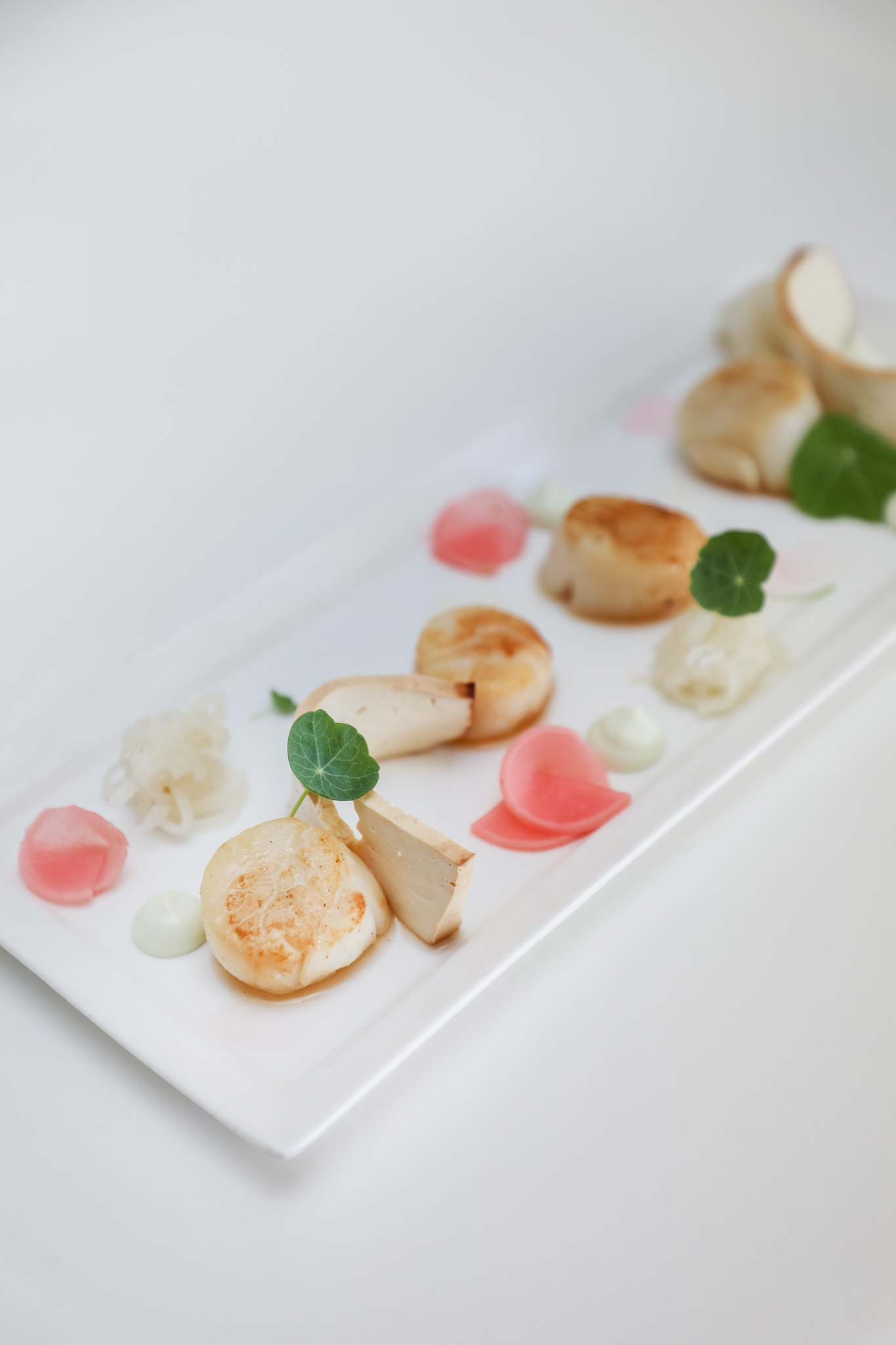 A well presented meal of scallops.