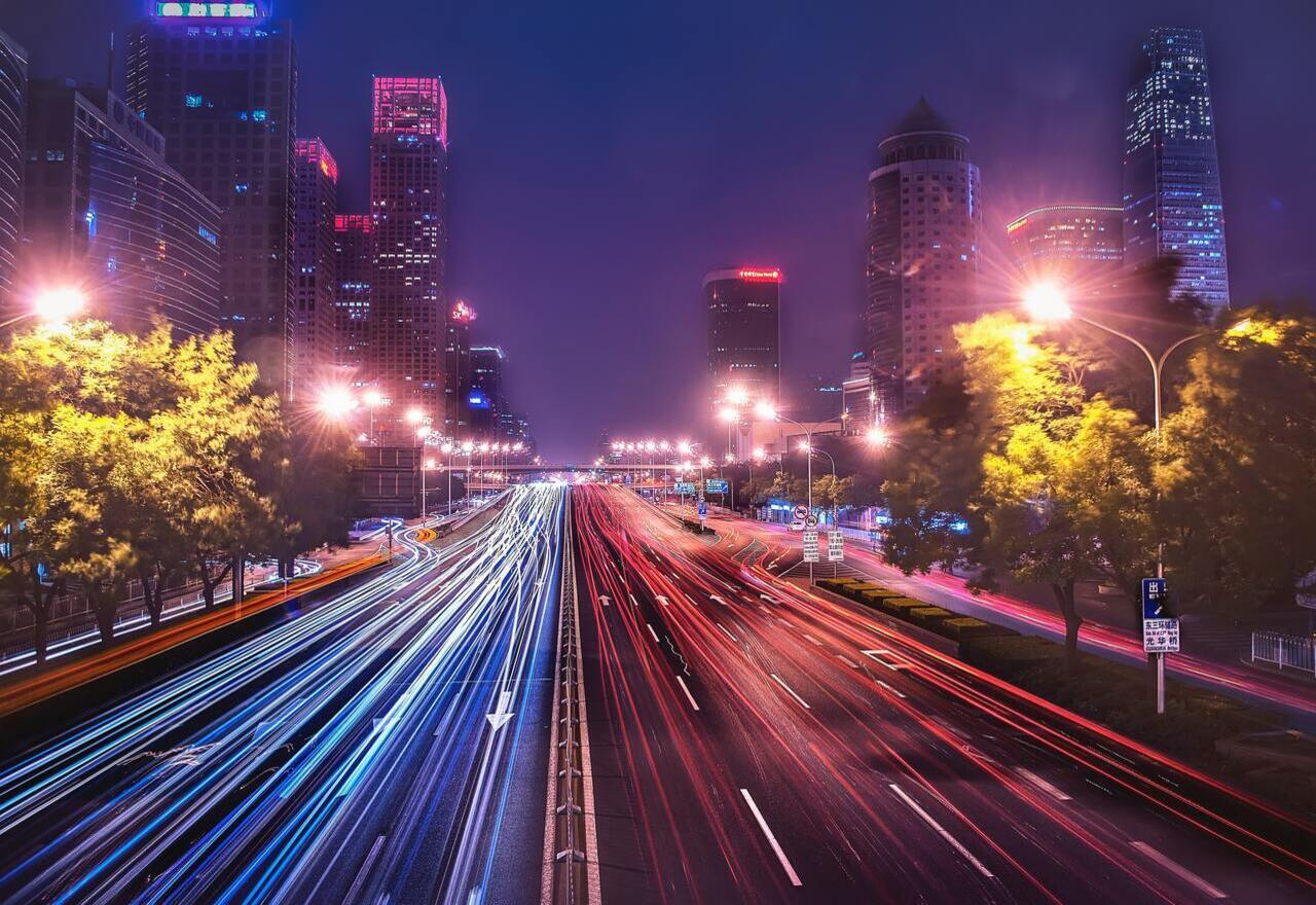 Long exposure image of cars zooming past on a busy highway in China