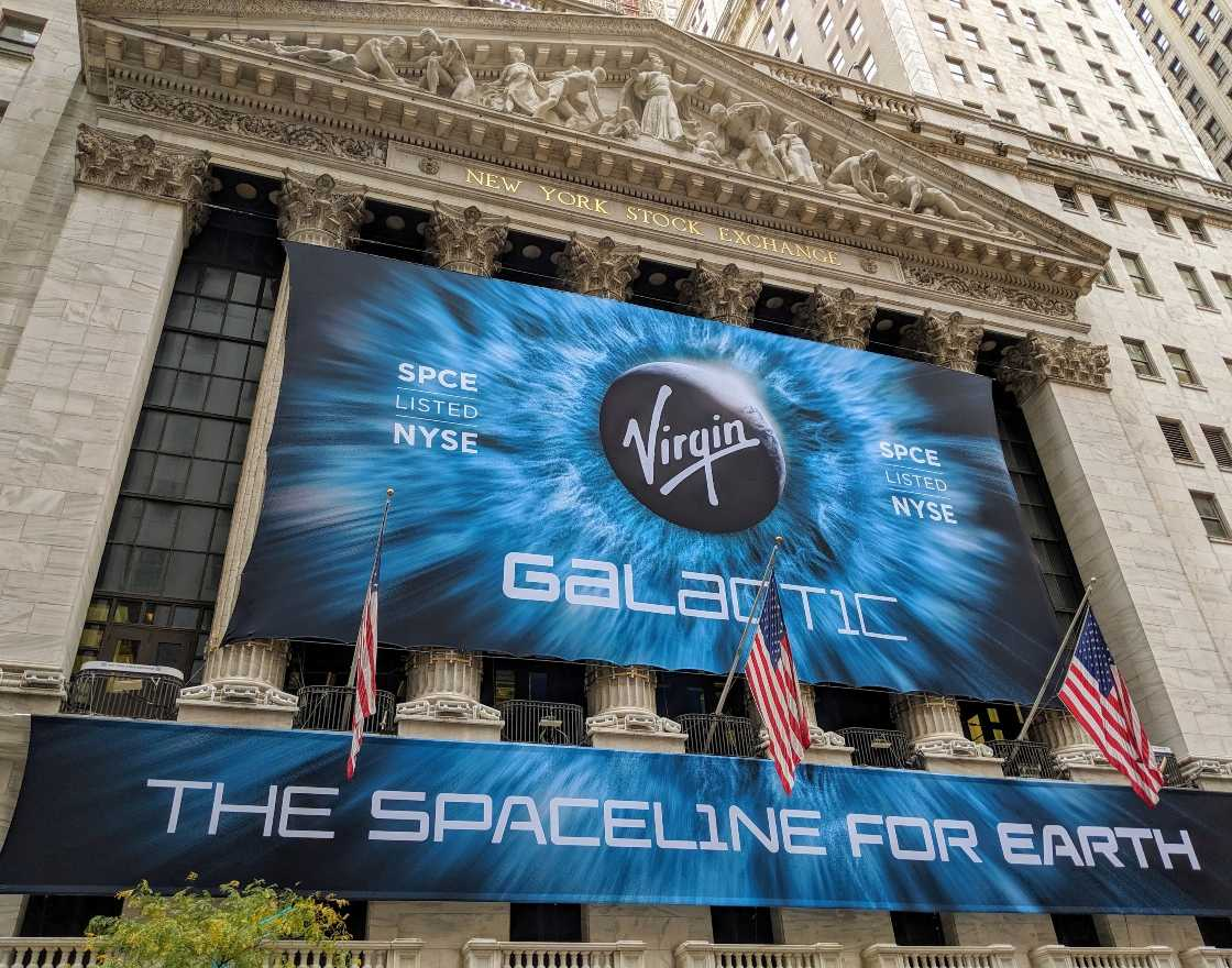Virgin Galactic Banner in front of nice building